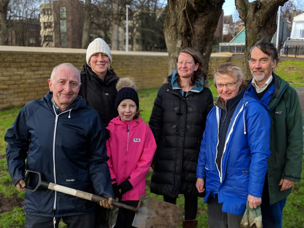 Group of people who were planting bulbs